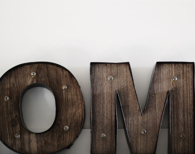 OM wooden letters