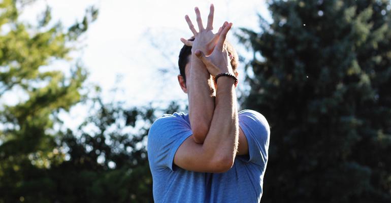 Yogi in eagle pose