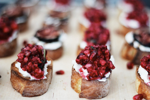 Holiday Crostini with pomegranate and cranberry topping